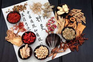 Mandarin calligraphy script on rice paper describing acupuncture chinese medicine as a traditional  and effective medical solution.
